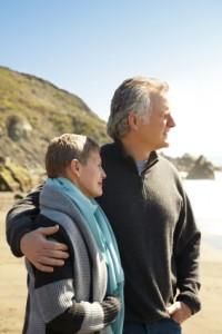 Death and Finances, couple on the beach